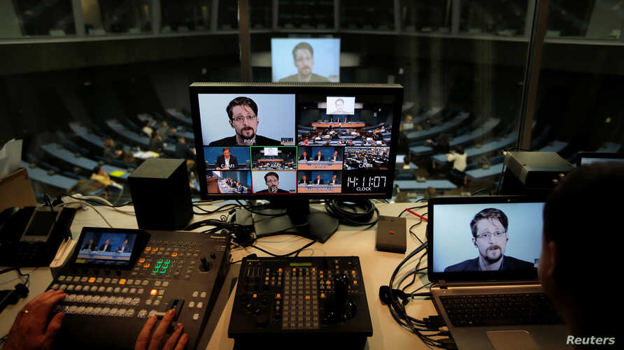Edward Snowden speaks via video link as he takes part in a round table on the protection of whistleblowers at the Council of Europe in Strasbourg, France, March 15, 2019.   REUTERS/Vincent Kessler