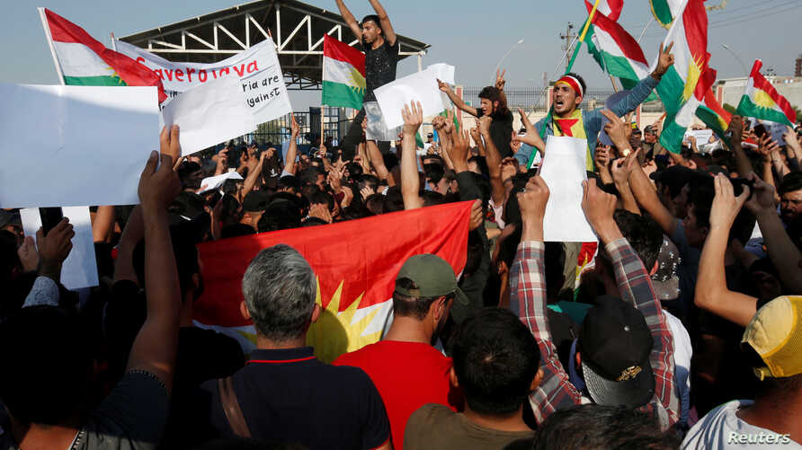 Syrian Kurds protest the Turkish offensive against Syria during a demonstration in front of the United Nation Headquarter in…