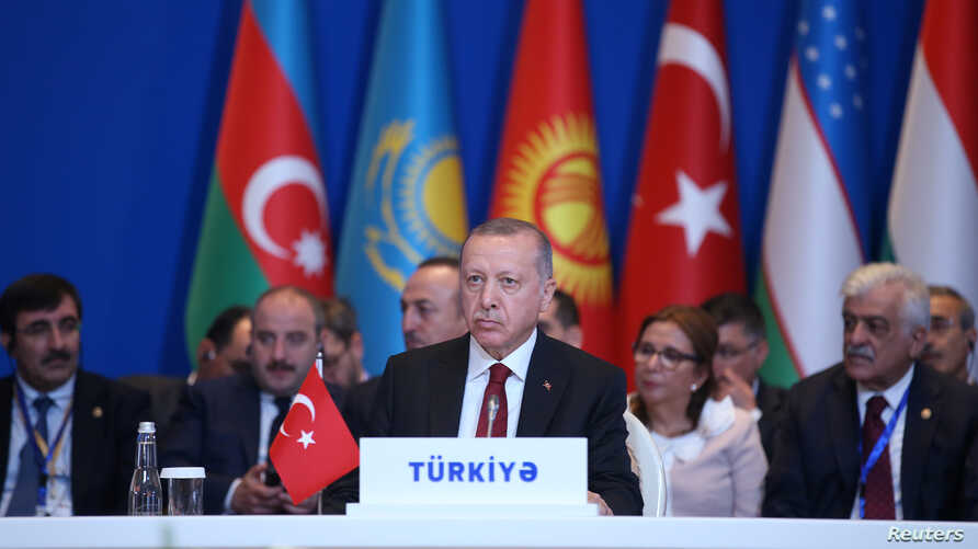 Turkish President Tayyip Erdogan attends a meeting of the Turkic Council in Baku, Azerbaijan October 15, 2019. Mustafa Kamaci…