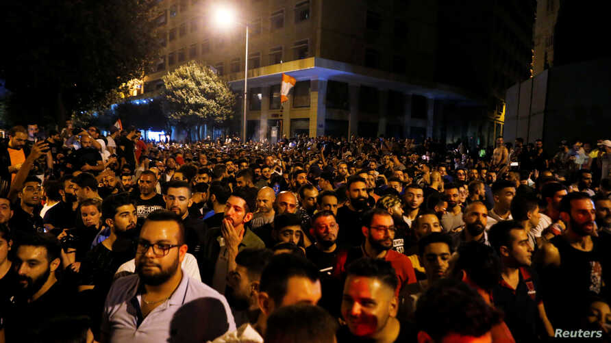 Demonstrators gather during a protest over deteriorating economic situation in Beirut, Lebanon October 17, 2019. REUTERS…