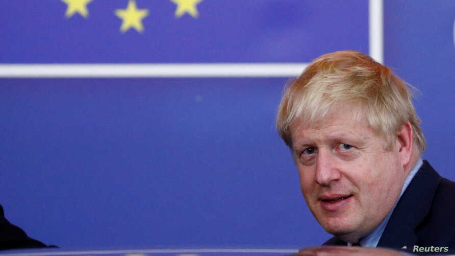 Britain's Prime Minister Boris Johnson leaves the European Council after the Brexit-dominated European Union leaders summit in…