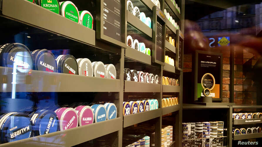 """Moist powder tobacco """"snus"""" cans are seen on shelves at a Swedish Match store in Stockholm, Sweden October 24, 2018. Picture…"""