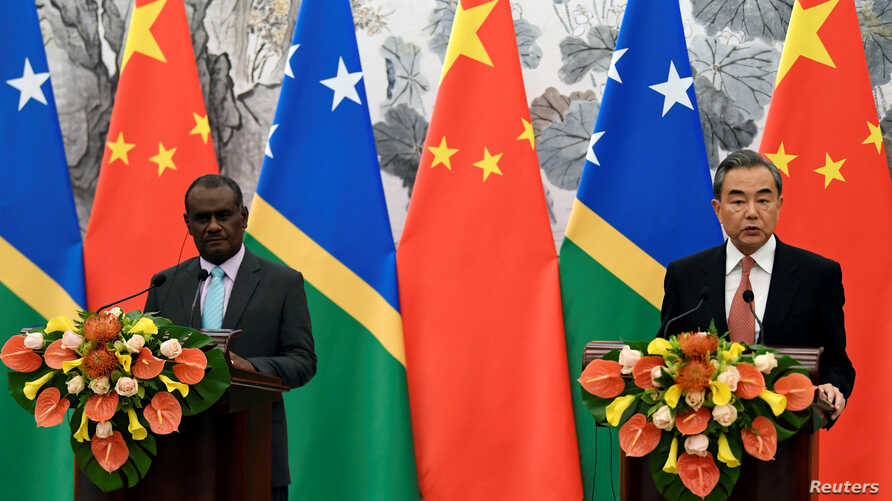 Solomon Islands Foreign Minister Jeremiah Manele and Chinese State Councilor and Foreign Minister Wang Yi hold joint news…
