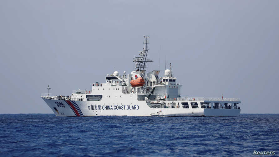 FILE PHOTO: A China Coast Guard vessel patrols at the disputed Scarborough Shoal April 6, 2017. REUTERS/Erik De Castro/File…
