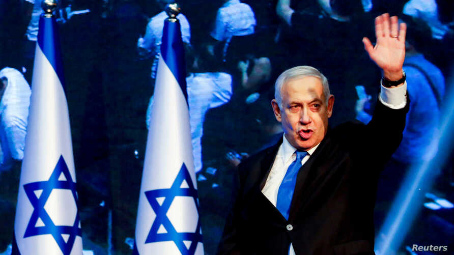 FILE PHOTO: Israeli Prime Minister BenjaminNetanyahu arrives at the Likud party headquarters following the announcement of exit polls during Israel's parliamentary election in Tel Aviv, Israel September 18, 2019. REUTERS/Ammar Awad/File Photo