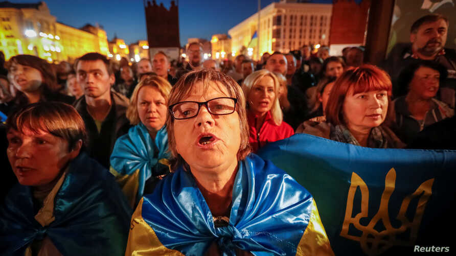 People attend a rally against approval of so-called Steinmeier Formula, in Kiev, Ukraine October 2, 2019.  REUTERS/Valentyn Ogirenko