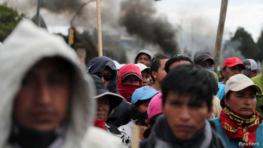 People block a road during protests after Ecuador's President Lenin Moreno's government ended four-decade-old fuel subsidies,…