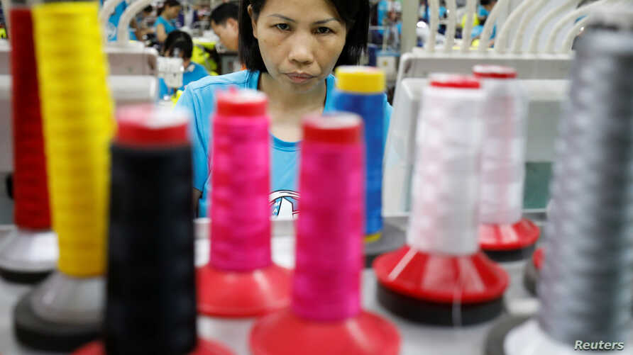 A woman works at Maxport garment company in Hanoi, Vietnam May 15, 2019. Picture taken May 15, 2019. REUTERS/Kham