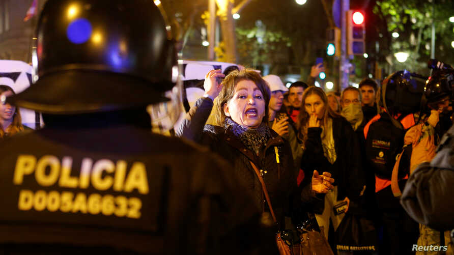 A Catalan separatist demonstrator shouts slogans during a civil disobedience protest one day ahead of Spain's general election…