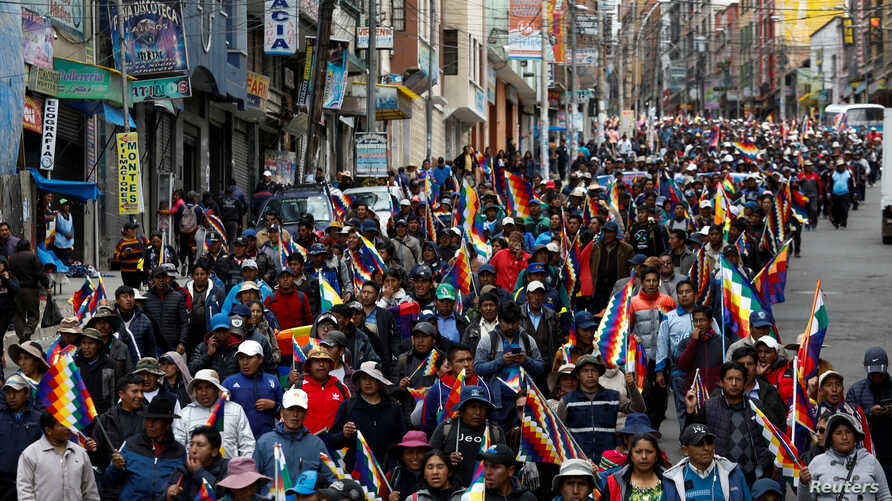 Supporters of former Bolivian President Evo Morales take part in a protest, in La Paz, Bolivia November 13, 2019. REUTERS/Marco…