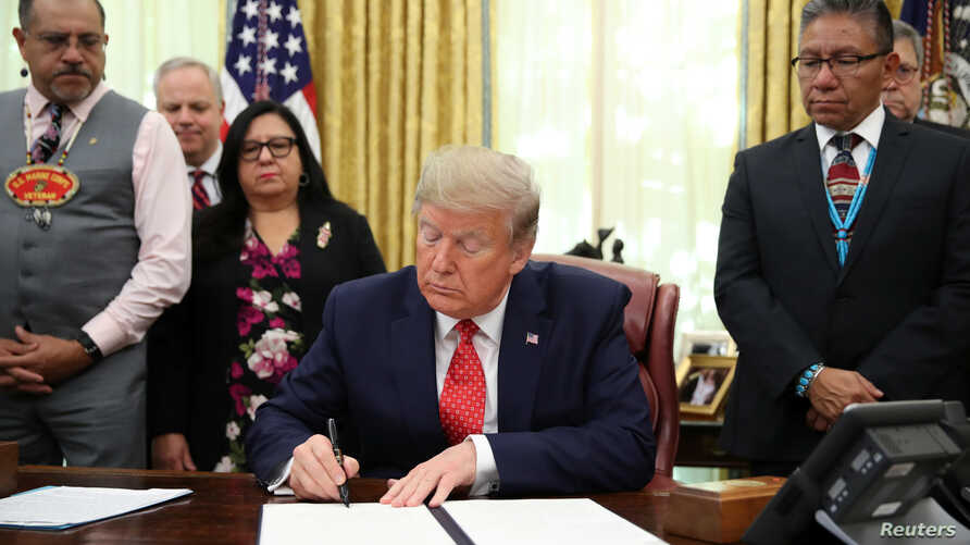 U.S. President Donald Trump signs an Executive Order to address the issue of missing and murdered Native Americans in the Oval…