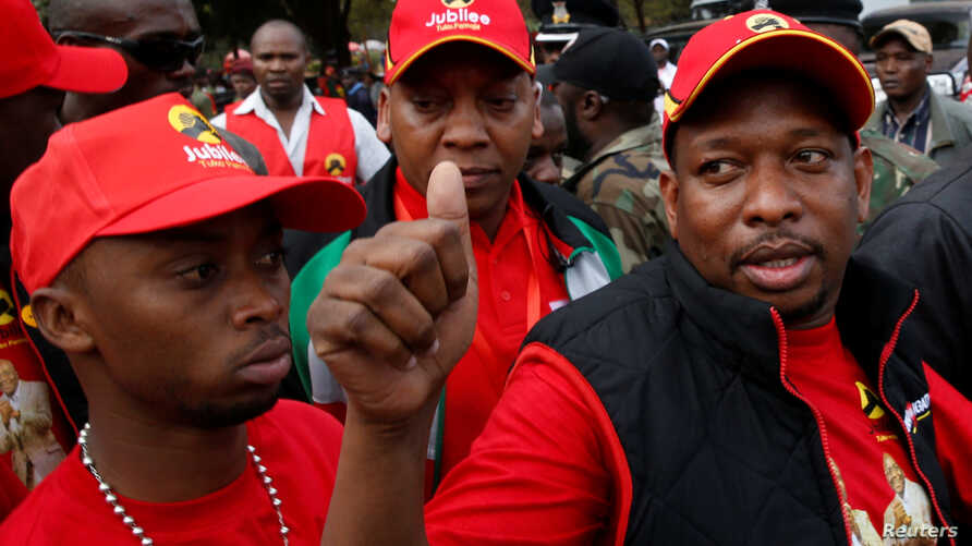 Nairobi's Governor-elect Mike Sonko salutes supporters as he arrives for a Jubilee Party campaign rally at Uhuru park in…