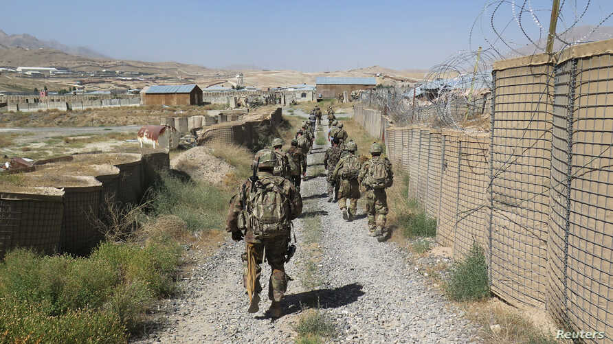 U.S. military advisers from the 1st Security Force Assistance Brigade walk at an Afghan National Army base in Maidan Wardak…