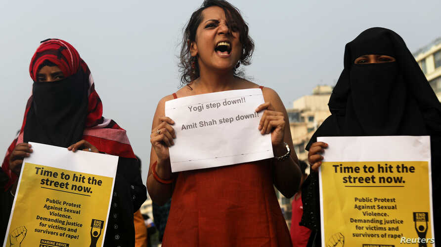 Women hold placards and shout slogans during a protest in solidarity with rape victims and to oppose violence against women in…