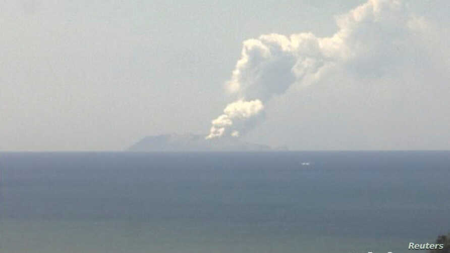 Smoke bellows from Whakaari, also known as White Island, volcano as it erupts in New Zealand, December 9, 2019, in this image…