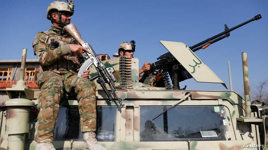 Afghan security forces inspect the site of an attack in a U.S. military air base in Bagram, north of Kabul, Afghanistan…