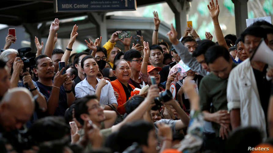 Supporters wave their hands at a sudden unauthorised rally by the progressive Future Forward Party in Bangkok, Thailand…