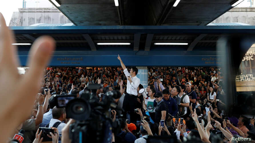 Thanathorn Juangroongruangkit of Thailand's progressive Future Forward Party gestures to his supporters at a sudden…