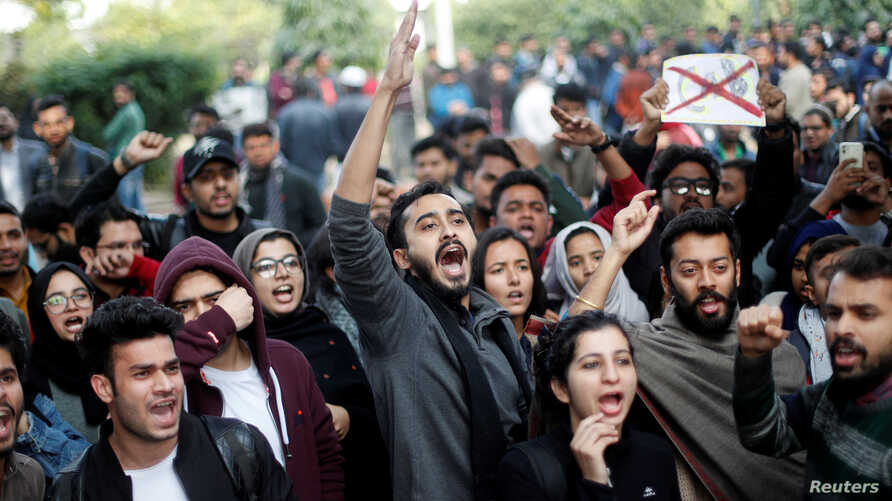 Protesters shout slogans during a protest against the Citizenship Amendment Bill, that seeks to give citizenship to religious…
