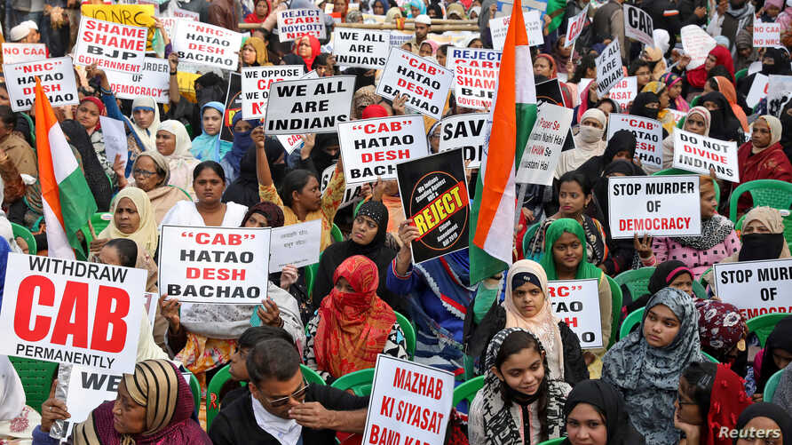 Women display placards during a protest, organised by West Bengal State Jamiat-e-Ulama, an Islamic organisation, against a new…