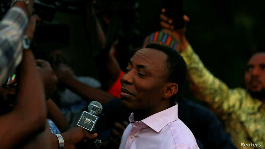 Former presidential candidate Omoyele Sowore talks to the media after being released on bail by Nigeria's government, in Abuja,…