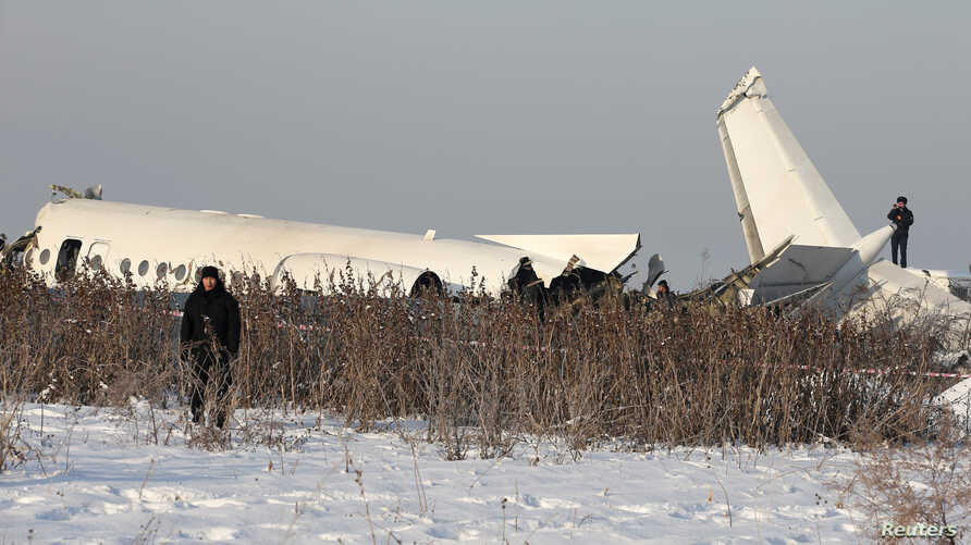 Emergency and security personnel are seen at the site of a plane crash near Almaty, Kazakhstan, December 27, 2019. REUTERS…