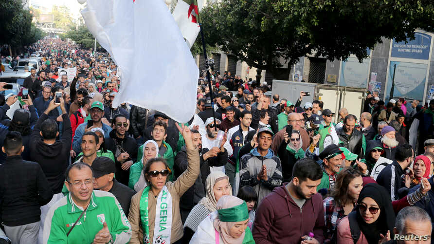 Demonstrators shout slogans during an anti-government rally in Algiers, Algeria December 27, 2019. REUTERS/Ramzi Boudina