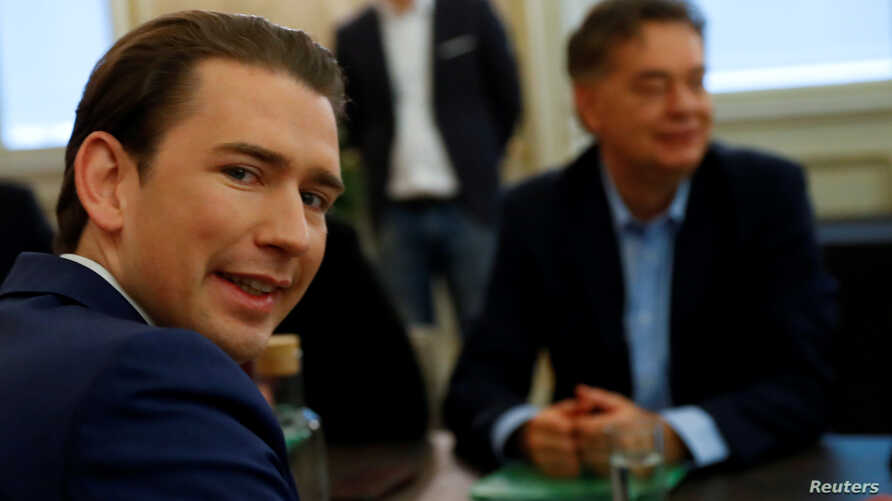 FILE PHOTO: Austrian Conservative leader Sebastian Kurz (L) and Greens party chief Werner Kogler meet for coalition talks in…