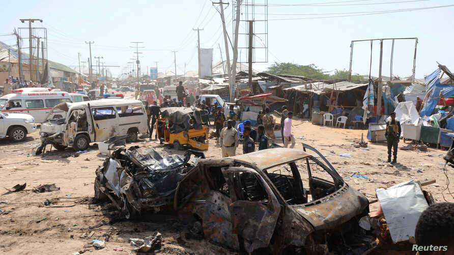 A general view shows the scene of a car bomb explosion at a checkpoint in Mogadishu, Somalia  December 28, 2019. REUTERS/Feisal…