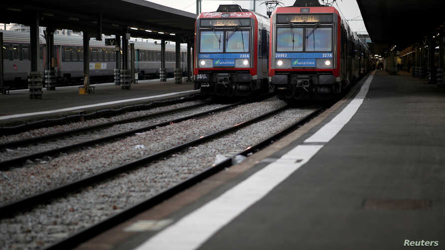 Local trains stand by next to empty platforms at Gare d'Austerlitz railway station after 25 days of strike by all unions of the…