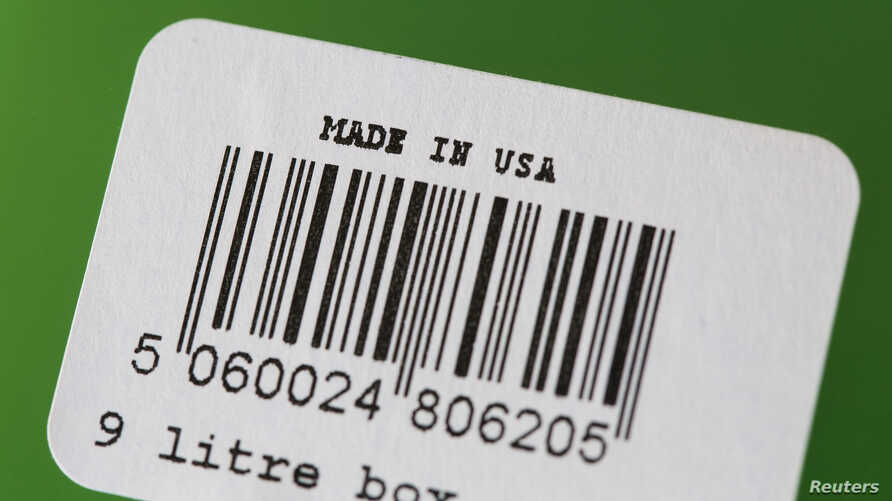 """A barcode label with """"Made In U.S.A."""" written on it is pictured on a plastic tote in San Diego, California January 29, 2014. U…"""