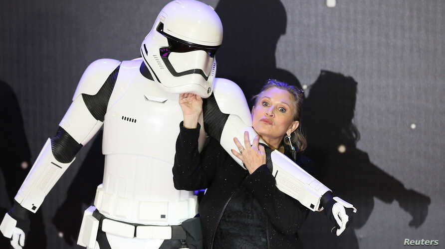 Carrie Fisher poses for cameras as she arrives at the European Premiere of Star Wars, The Force Awakens in Leicester Square,…