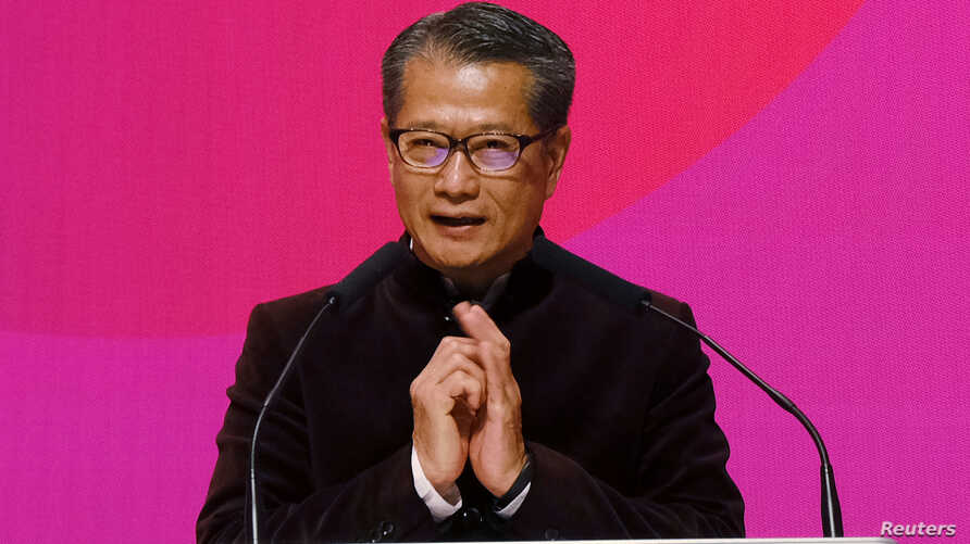 Hong Kong Financial Secretary Paul Chan speaks during a ceremony marking the first day of trade after Lunar New Year at the…
