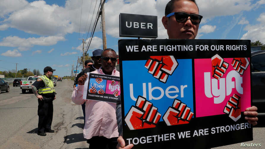Uber and Lyft drivers protest during a day-long strike outside Uber's office in Saugus, Massachusetts, U.S., May 8, 2019.  …