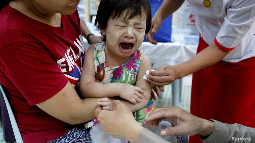 A child reacts after receiving a measles-rubella vaccination in Yangon, Myanmar, November 26, 2019. REUTERS/Ann Wang