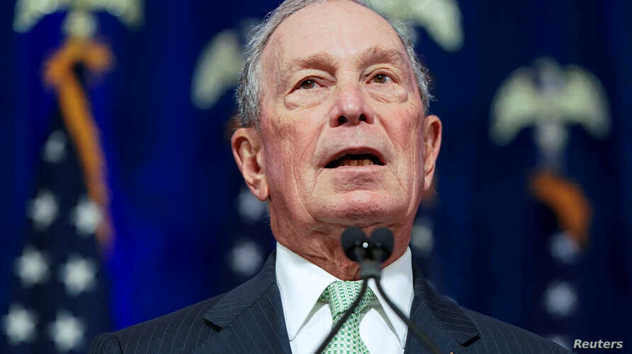 FILE PHOTO: Democratic U.S. presidential candidate Michael Bloomberg addresses a news conference after launching his…