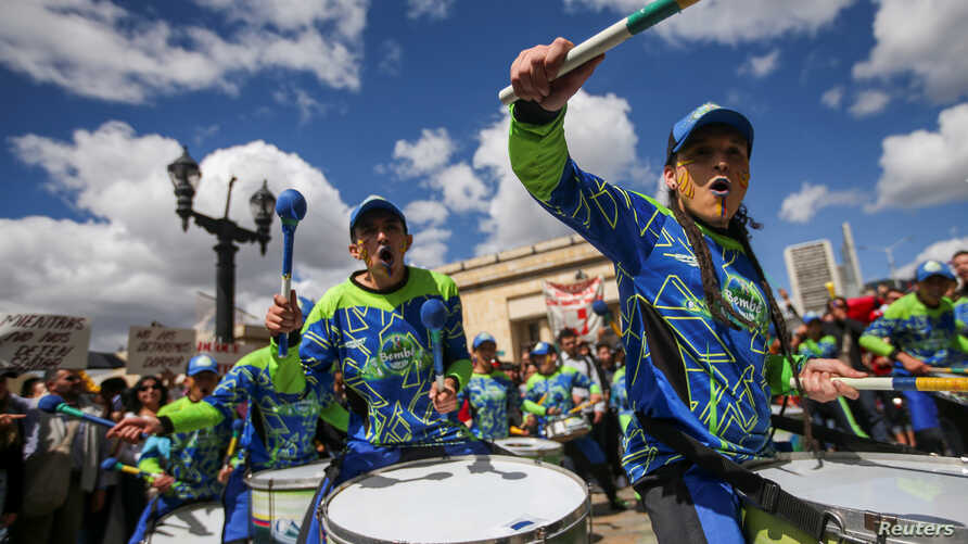 Members of a drums band perform during a protest as a national strike continues in Bogota, Colombia December 4, 2019. REUTERS…