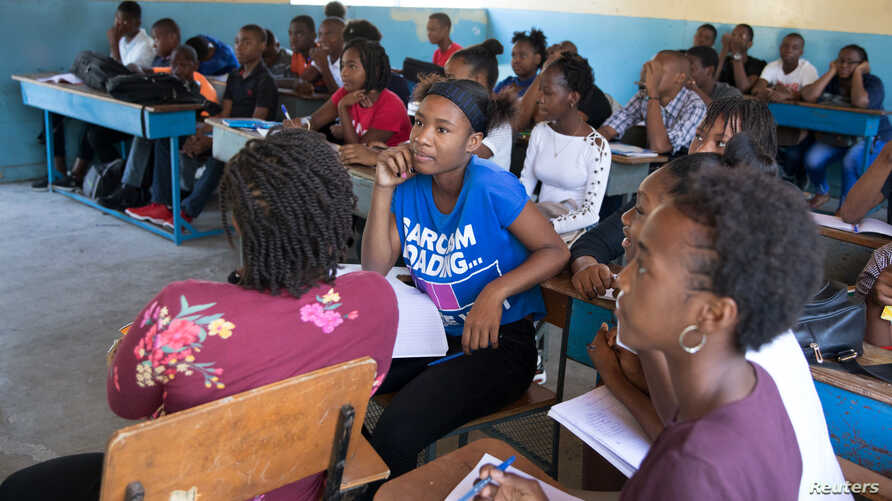 Students attend a class at the College Saint Pierre-Eglise Episcopale D'Haiti as schools and businesses tentatively reopen…