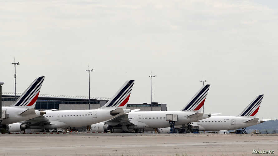 Air France planes are parked on the tarmac at the Paris Charles de Gaulle airport in Roissy, France, June 19, 2019. Picture…