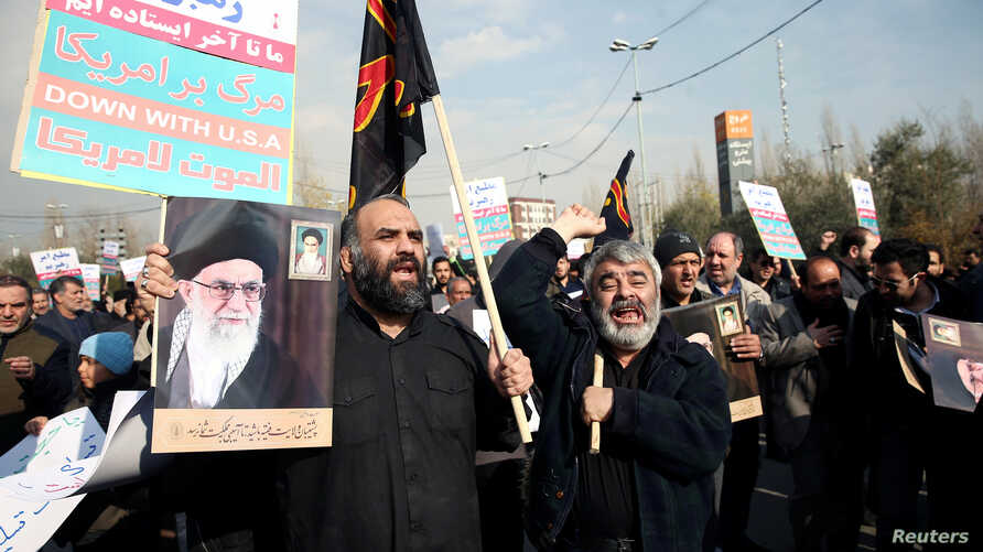 Demonstrators react during a protest against the assassination of the Iranian Major-General Qassem Soleimani, head of the elite…