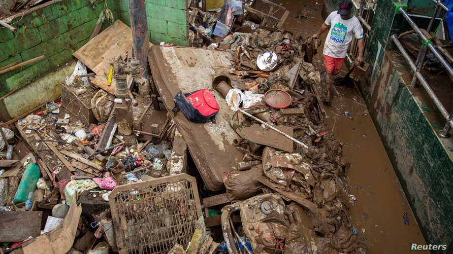 A man cleans up the clay after floods hit in Jakarta, Indonesia, January 3, 2020 in this photo taken by Antara Foto.  Antara…