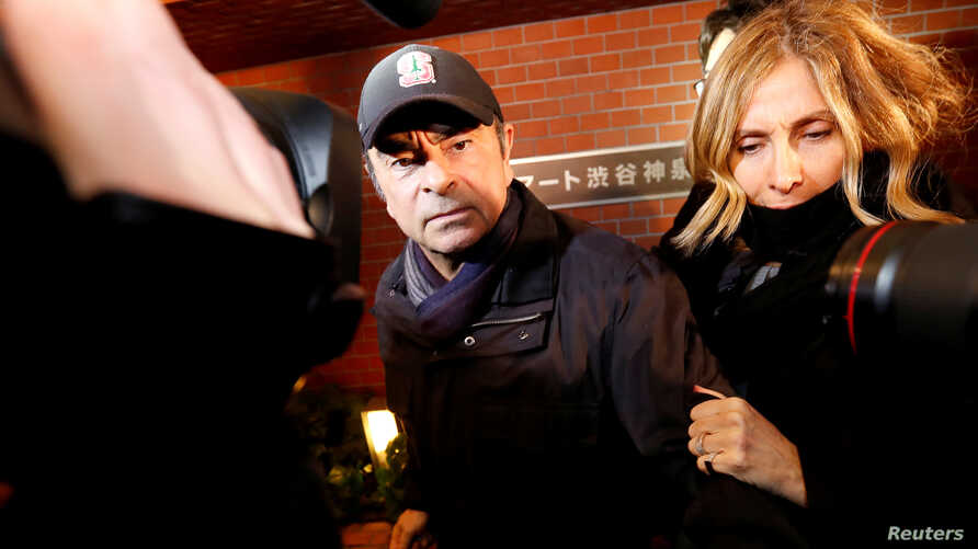 FILE PHOTO: Former Nissan Motor Chairman Carlos Ghosn accompanied by his wife Carole Ghosn, arrives at his place of residence…