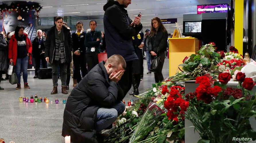 Relatives of the flight crew members of the Ukraine International Airlines Boeing 737-800plane that crashed in Iran, mourn at…