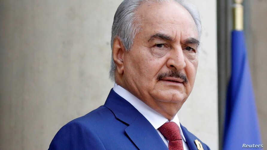 FILE PHOTO: Khalifa Haftar, the military commander who dominates eastern Libya, arrives to attend an international conference…