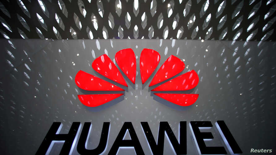 FILE PHOTO: A Huawei company logo at Shenzhen International Airport in Shenzhen, Guangdong province, China, July 22, 2019…