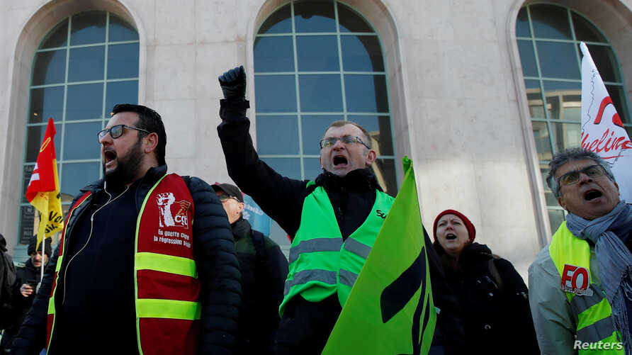 FILE PHOTO: French labour unions and workers on strike demonstrate against French government's pensions reform plans near the…