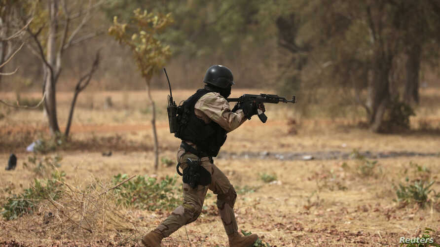 FILE PHOTO: A soldier from Burkina Faso participates in a simulated raid during the U.S. sponsored Flintlock exercises in…