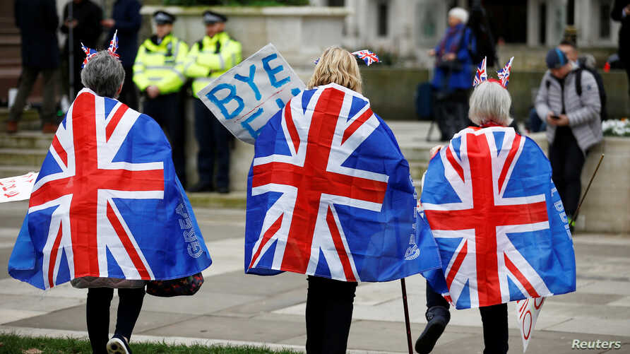 People celebrate Britain leaving the EU on Brexit day at Parliament Square in London, Britain January 31, 2020. REUTERS/Henry…
