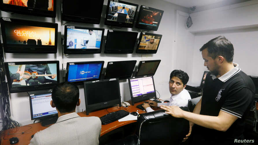 Afghan journalists work in the Tolo newsroom, in Kabul, Afghanistan September 7, 2018. Picture taken September 7, 2018. REUTERS…