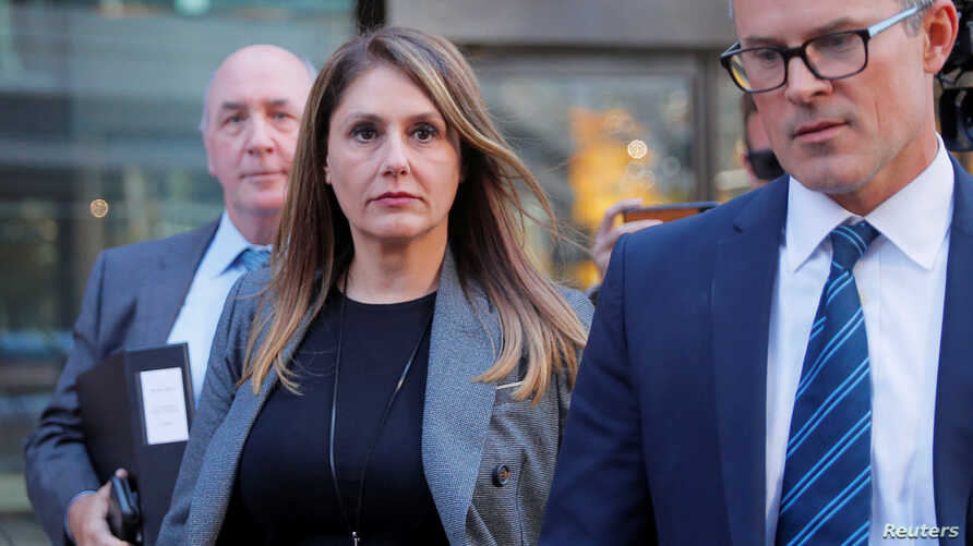 FILE - Michelle Janavs, former executive of a large food manufacturer, leaves the federal courthouse after entering a plea in a nationwide college admissions cheating scheme in Boston, Massachusetts, Oct. 21, 2019.